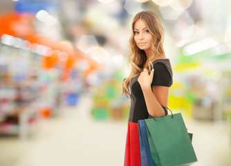 woman with shopping bags at store or supermarket