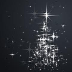 Christmas tree from bright sparkles, shiny stars