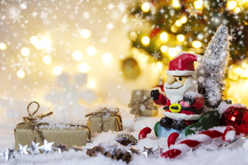 Christmas decoration santa claus and pine tree on the snow