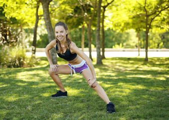 Girl doing stretching in the park