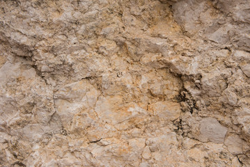Background quarried rough textured limestone rock