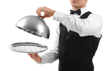 Male waiter holding cloche and tray on white background