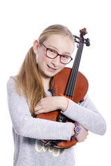 caucasian teenage girl wears glasses and hugs violin