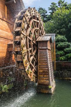 Chinese house and waterwheel at Nan lian Garden at Diamond Hill, Hong Kong