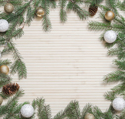 Christmas wooden background decorated fir branches and toys