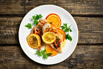 Grilled chicken breast with orange sauce, top view