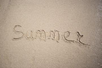 Hand made text in sand on a beach inscription summer - Sun and Sea