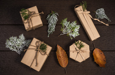 Flat lay photography of handmade gift boxes over dark wooden bac