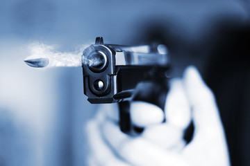 hand gun pistole with flying bullet fire