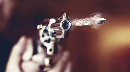 hand gun revolver with flying bullet fire
