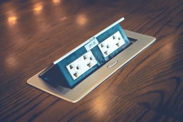 de focus of blur electric plug built in desk