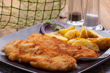 Fried cod fillet.