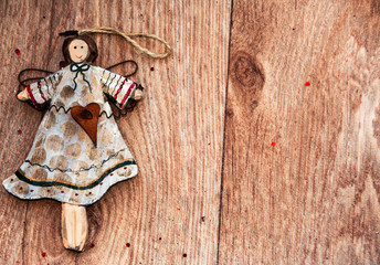 shabby chic wooden christmas angel on a wooden table