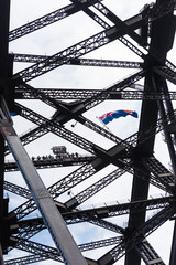 A group of people at the top of the Harbour Bridge in Sydney, Australia