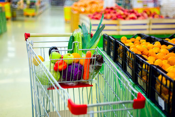 Cart with fresh fruits and vegetables in shopping centre