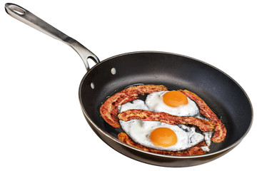 Sunny Side Up Eggs Fried with Bacon Rashers in Old Frying Pan Isolated On White Background