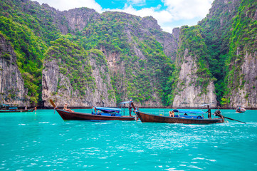 Long boat and blue water at Maya bay in Phi Phi Island, Krabi Th
