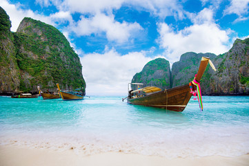 Long boat and blue water at Maya bay in Phi Phi Island, Krabi Th