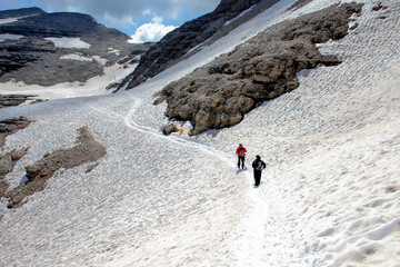 People hiking on the trails of the Sass Pordoi, Dolomites, Italy