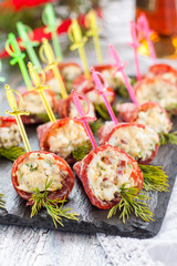 Appetizers with smoked sausage and cheese for buffet. Rolls of smoked sausage stuffed with cheese