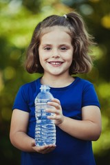 Cute little girl with water bottle