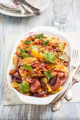 Кartoffelsalat. German potato salad. Salad with potatoes, bacon, red onion, pickles and sausages