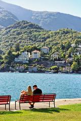 Couple sitting on bench at Ascona Switzerland