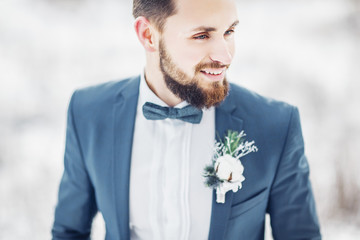 The groom is a bearded hipster. Winter wedding.