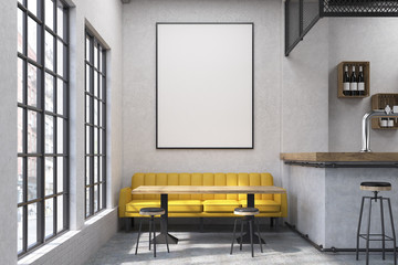 Close up of a cafe with a yellow sofa