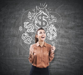 Ecstatic woman near a chalkboard with dollar signs