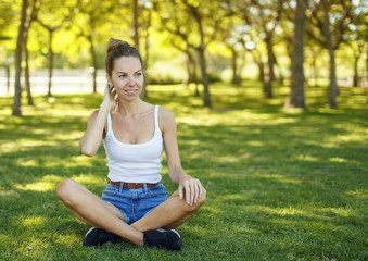 Girl sitting on the grass in the park
