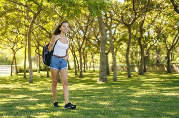 Girl walking with her backpack