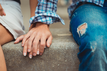 A young couple in love touched hands on the first date