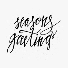 Season's Greetings card. Hand lettering calligraphic inscription by brush for Christmas, New Year greeting card template. Used for Christmas cards, prints, New Year posters, stamps, advertisement