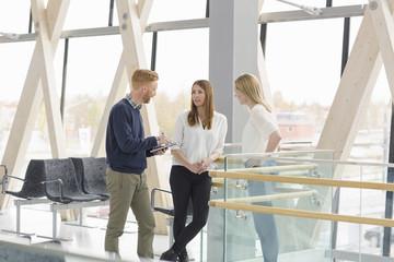 Sweden, Vasterbotten, Umea, Man and women standing and talking