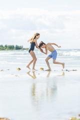 Sweden, Oland, Kopingsvik, Girl (10-11) and boy (8-9) dancing on beach