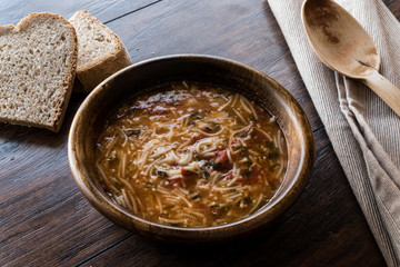 Turkish Traditional Vermicelli Soup in a wooden bowl / Tel sehri