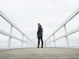 Sweden, Skane, Malmo, Man standing on pier