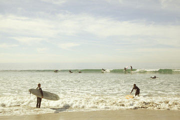 USA, California, Los Angeles, Venice, Surfers wading in sea