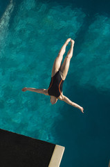 High angle view of a female swimmer in midair diving