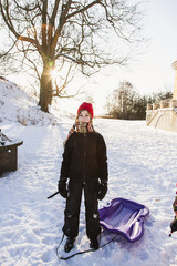 Sweden, Blekinge, Solvesborg, Portrait of girl (12-13) with plastic sled