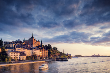 Sweden, Stockholm, Sodermalm, Sodermalarstrand, Waterfront at sunset