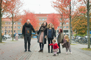 Sweden, Vastergotland, Gothenburg, Family with four daughters (2-3, 4-5, 10-11, 16-17) in street