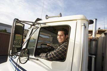 Portrait of mature man driving truck
