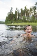 Sweden, Smaland, Braarpasjon, Boy (14-15) bathing in lake