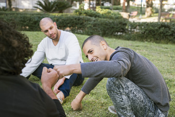 Israel, Tel Aviv, Men sitting in park