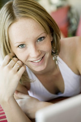 Young woman on lying on deckchair portrait close up