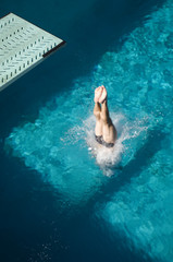 Canvas Prints Diving High angle view of a Caucasian female swimmer's legs diving into the pool