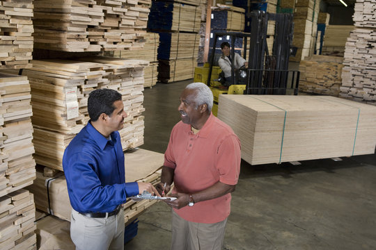 Men stock-taking in warehouse