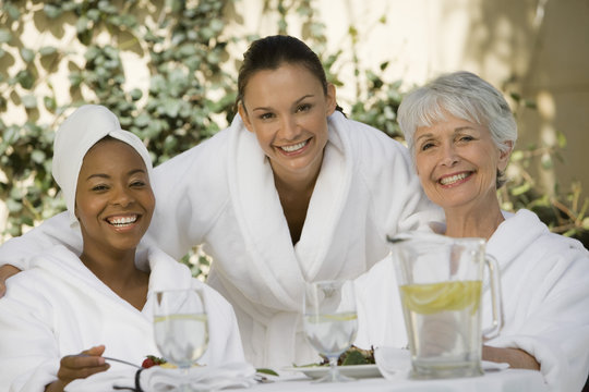 Portrait of multi ethnic female friends at dining table